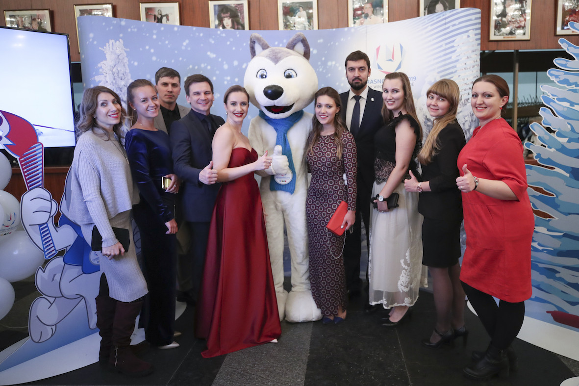 Guests at the Russian Students Sport Union gala in Moscow are drawn to the personal magnetism of the 2019 Krasnoyarsk Winter Olympiade mascot U-Laika ©RSSU
