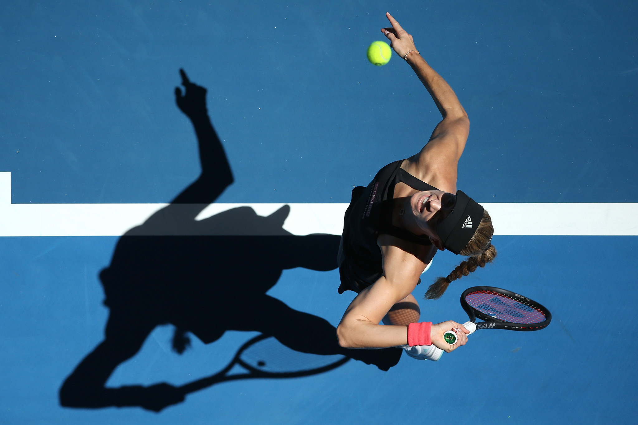 Germany's Angelique Kerber serves the ball in her victory against Garbine Muguruza in Germany and Spain's clash at the Hopman Cup in Perth ©Getty Image