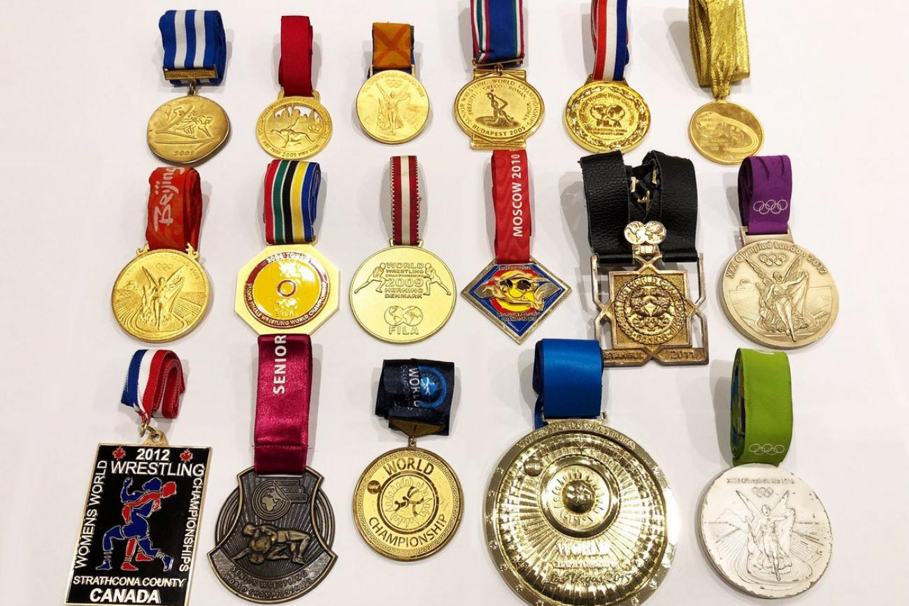 Saori Yoshida's medal collection includes three Olympic golds, 13 world golds and four golds from the Asian Games ©UWW