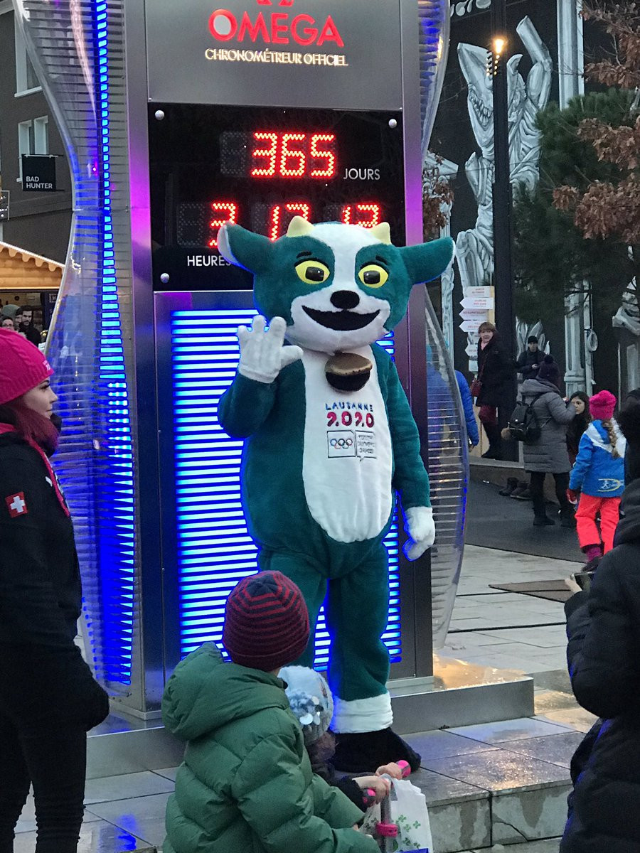 Lausanne 2020 mascot Yodli posed for photos in front of the countdown clock on the medal plaza ©Lausanne 2020
