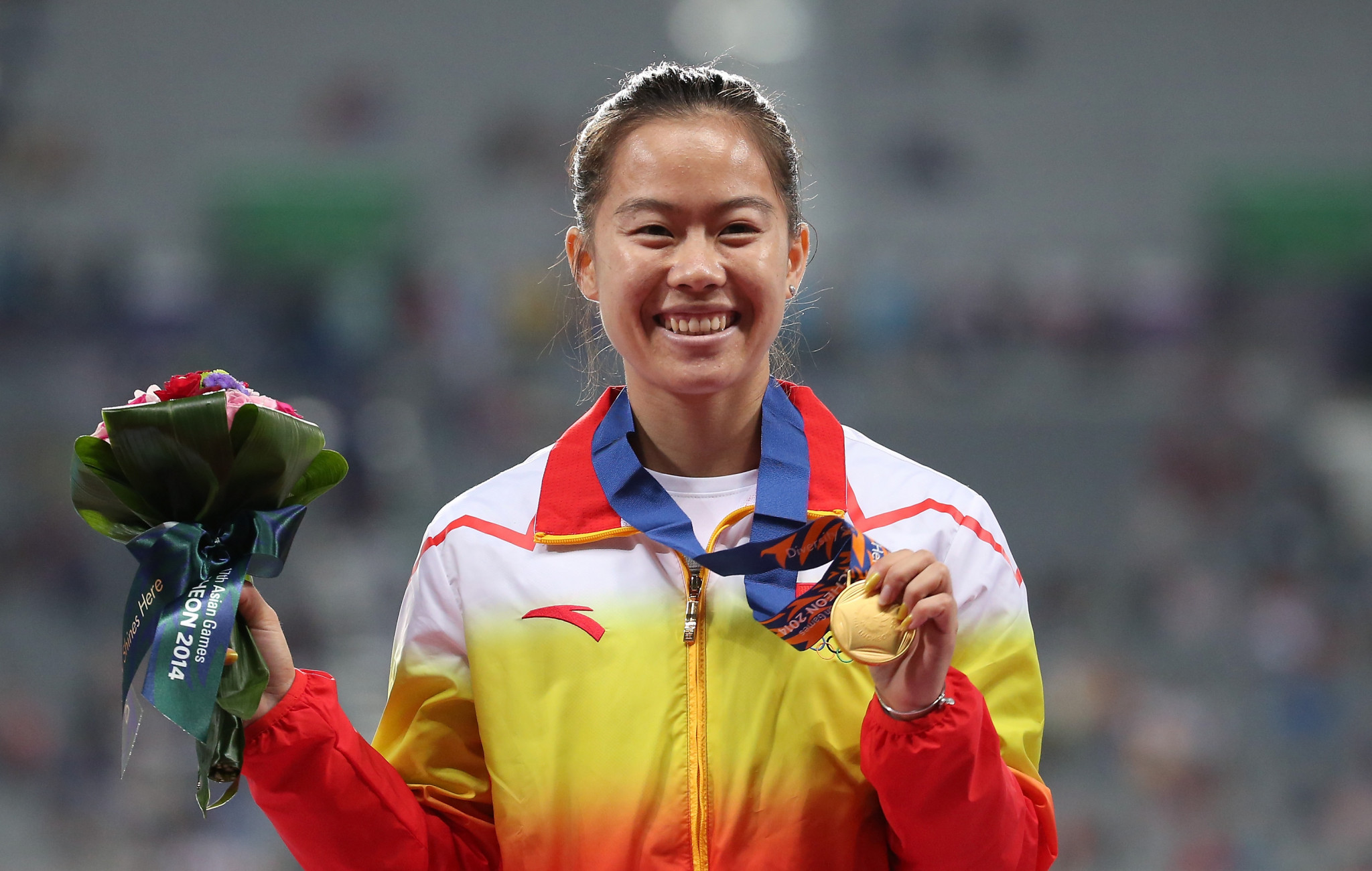 Asian Games gold medal-winning hurdler Wu Shuijiao of China has been given a four-year ban for doping ©Getty Images