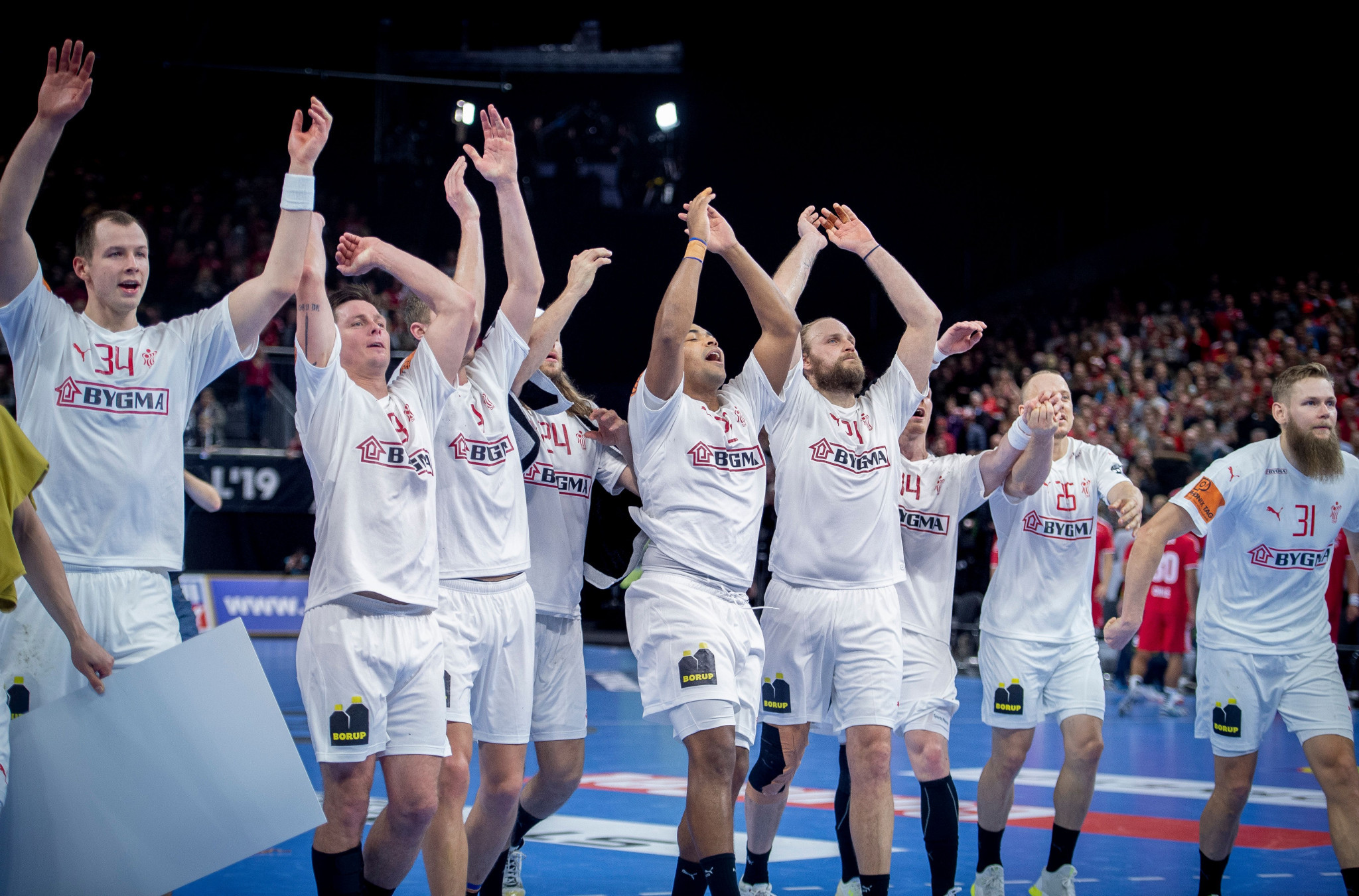 Denmark celebrate after beating Chile in their first game of the IHF Men's Handball World Championship ©Getty Images