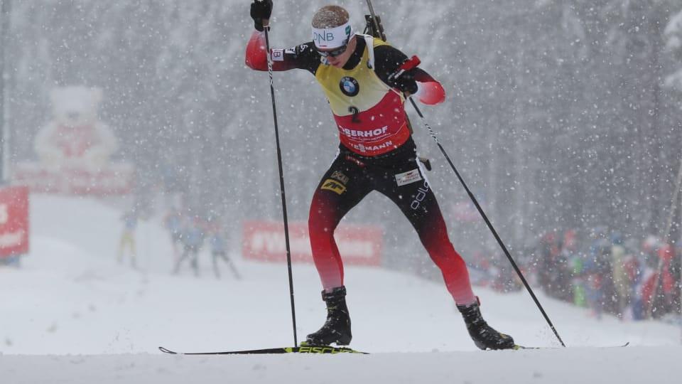 Norway's Johannes Thingnes Bø won the men's race during a heavy snowfall ©IBU