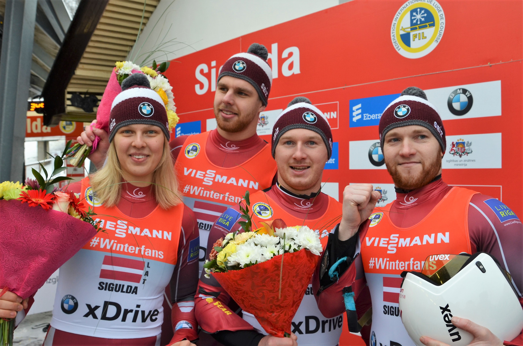 Latvia's relay team of Kendija Aparjode, Kristers Aparjods, Oskars Gudramovics and Peteris Kalnins delighted the crowd in Sigulda by winning the World Cup event today ©FIL
