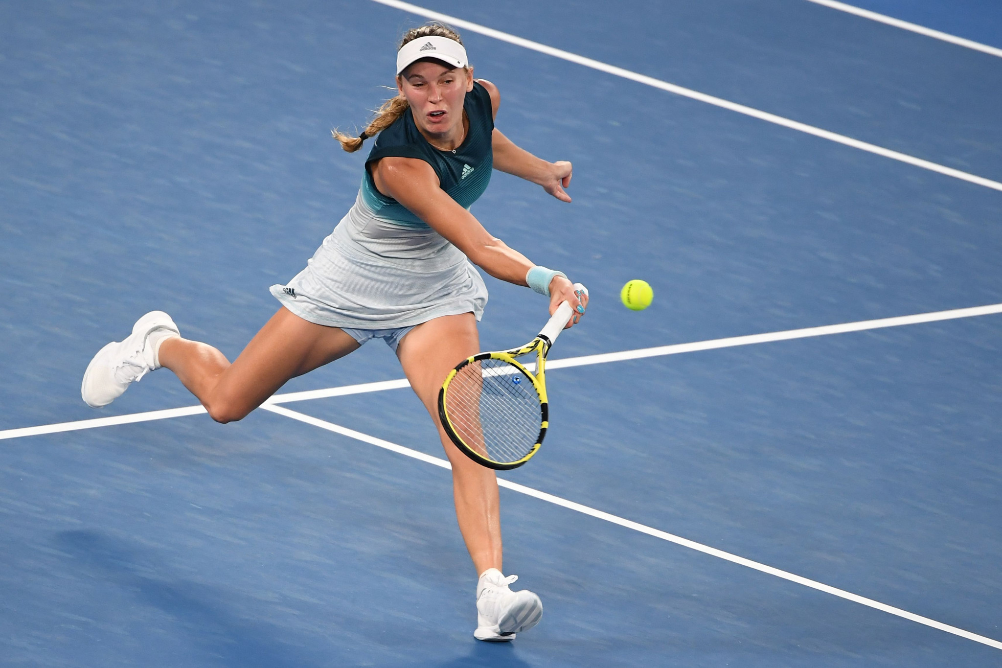 Defending women's singles champion Caroline Wozniacki won her first round match in straight sets ©Getty Images