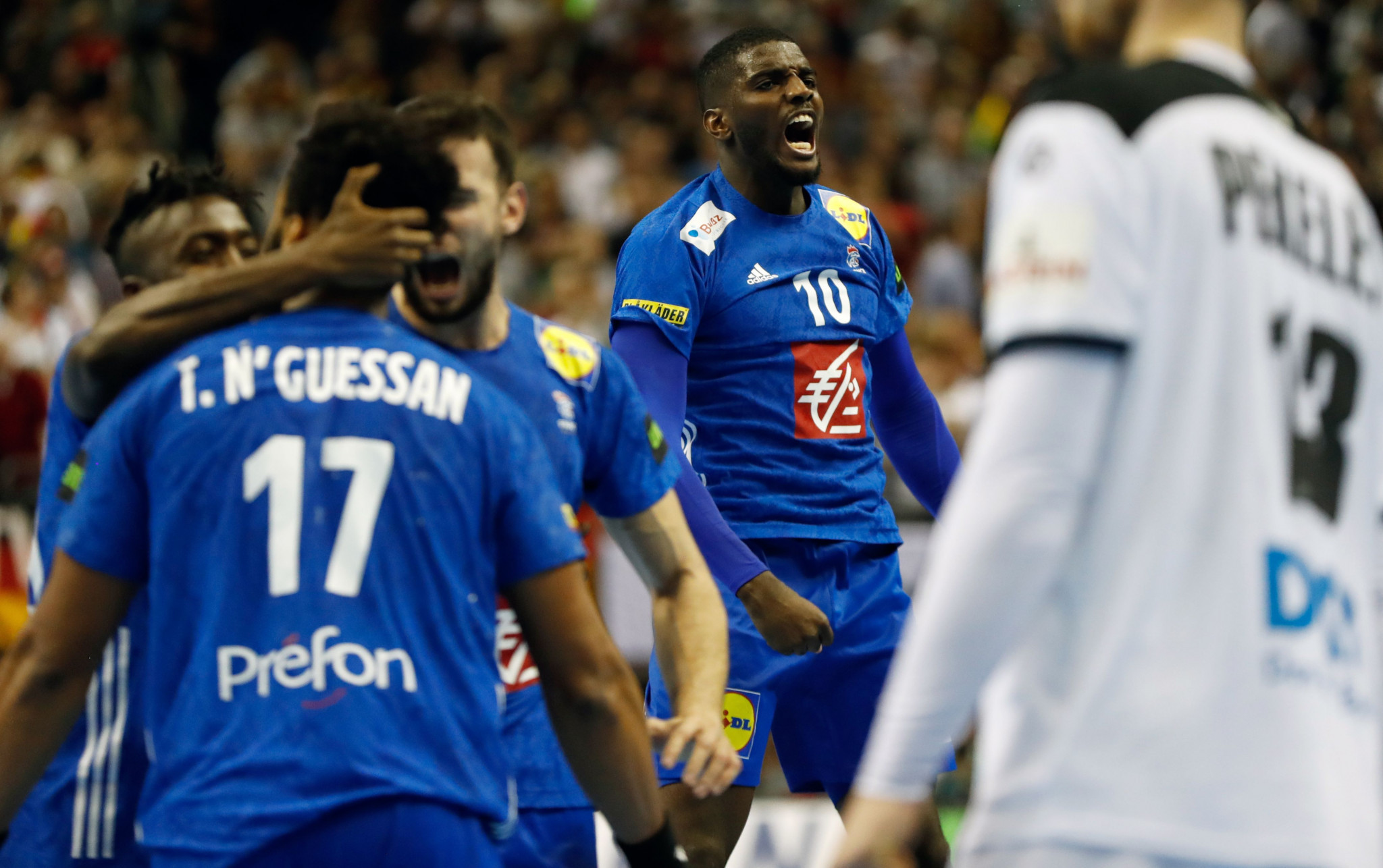 Defending champions strike late to preserve unbeaten record and hand Germany second draw at IHF Men's Handball World Championship