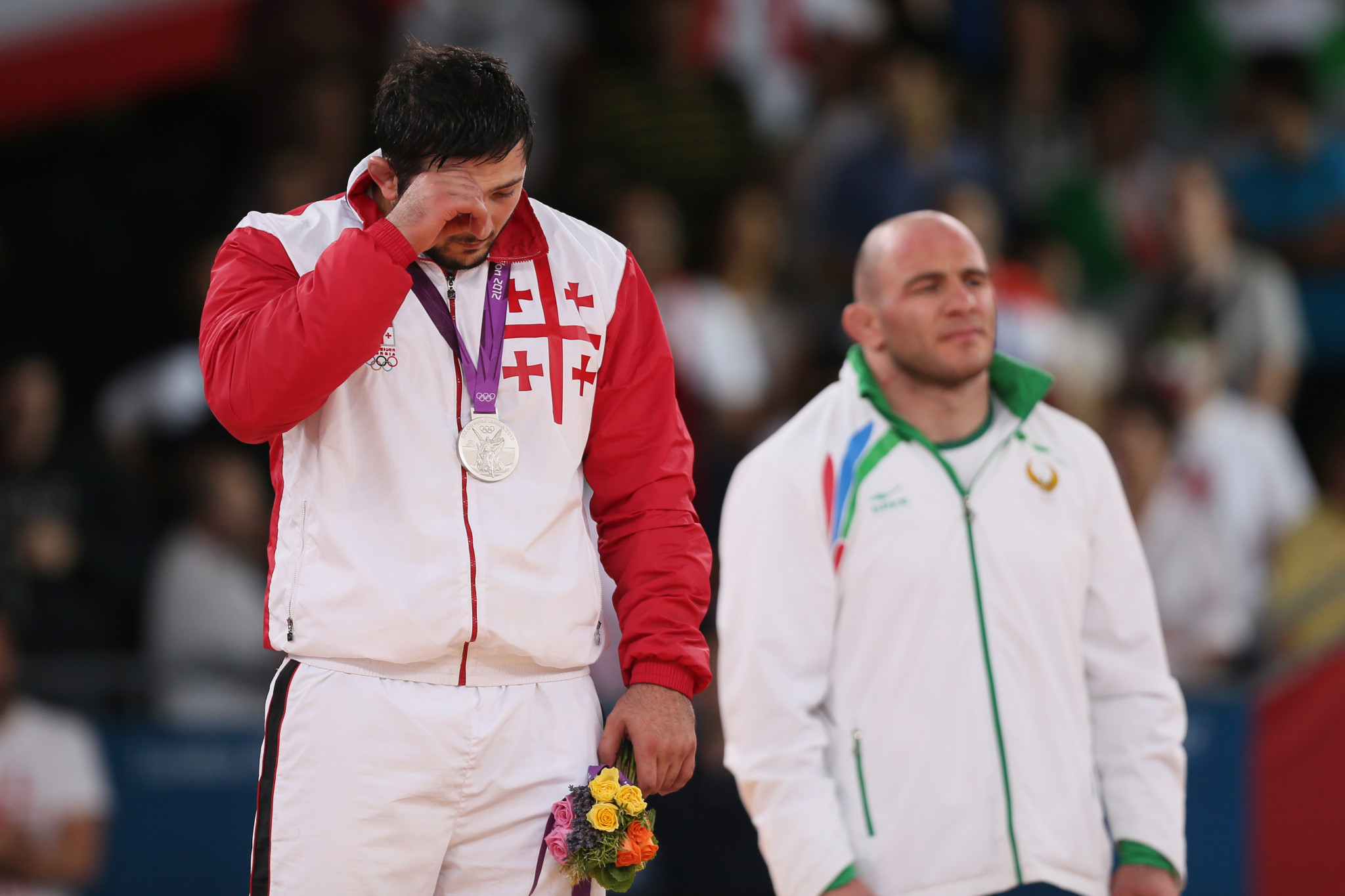 Davit Modzmanashvili lost to Uzbekistan's Artur Taymazov, right, in the 120kg final at London 2012 ©Getty Images