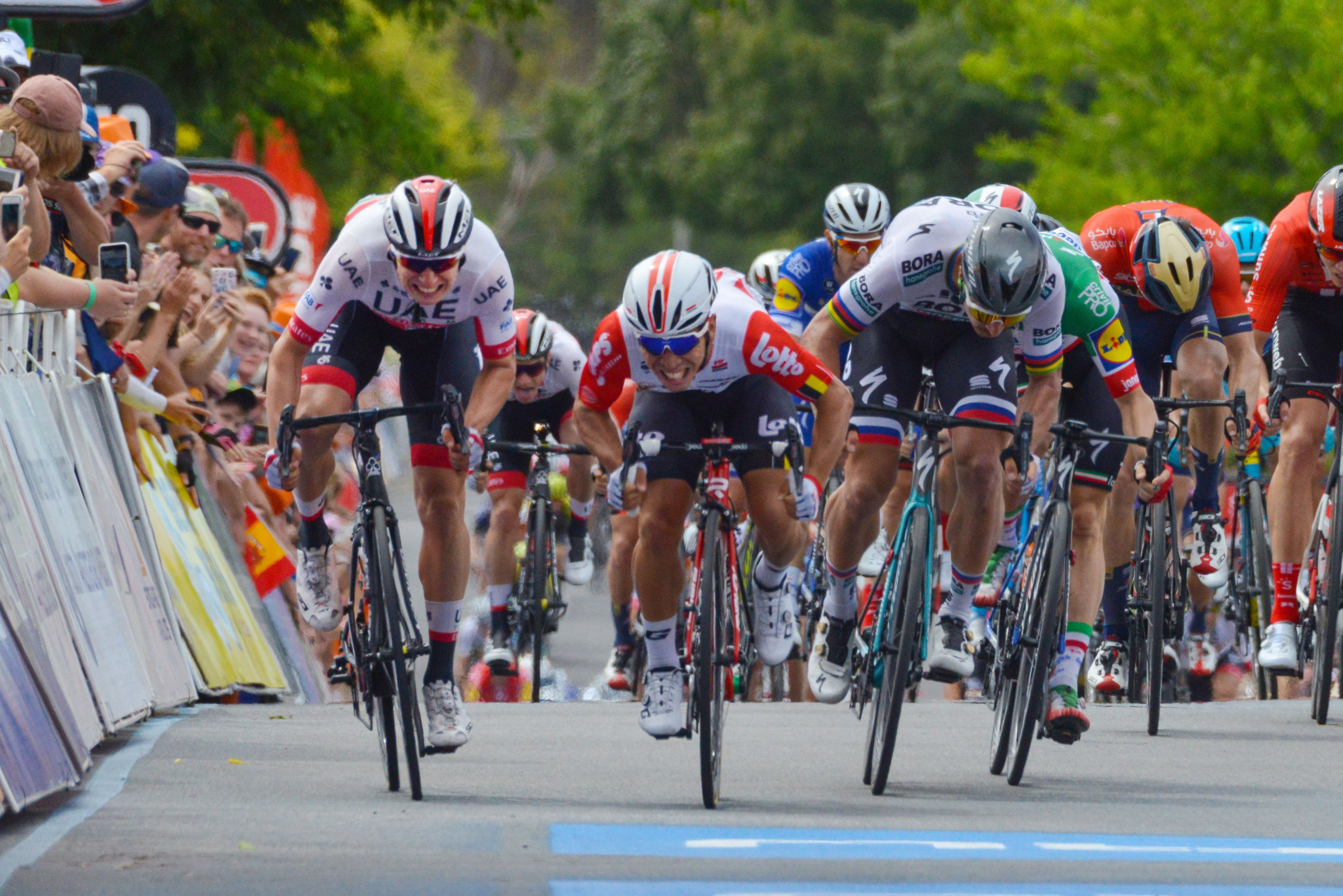 Caleb Ewan, centre, was dropped to the back of the front group following the alleged infringement ©Getty Images