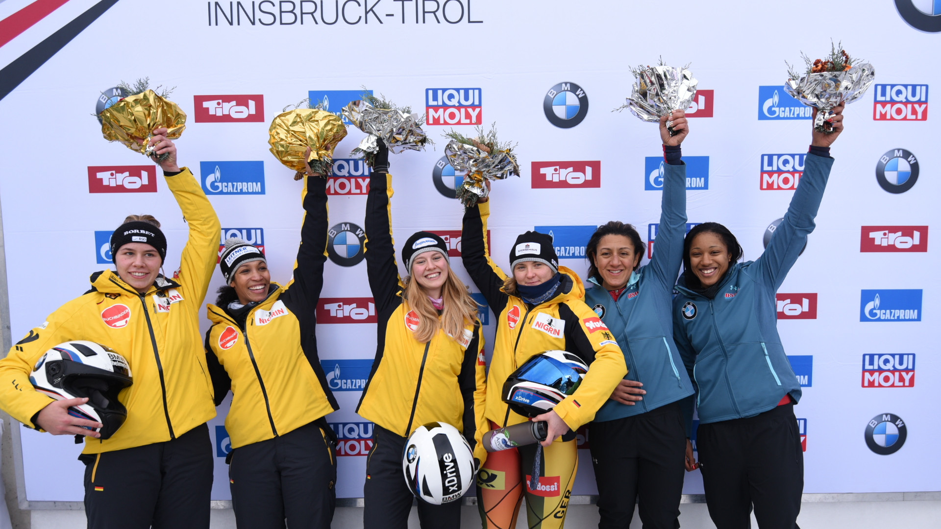 Germany's Stephanie Schneider, third right, and partner Ann-Kristin Strack top the podium at the IBSF women's bobsleigh World Cup event in Innsbruck ©IBSF