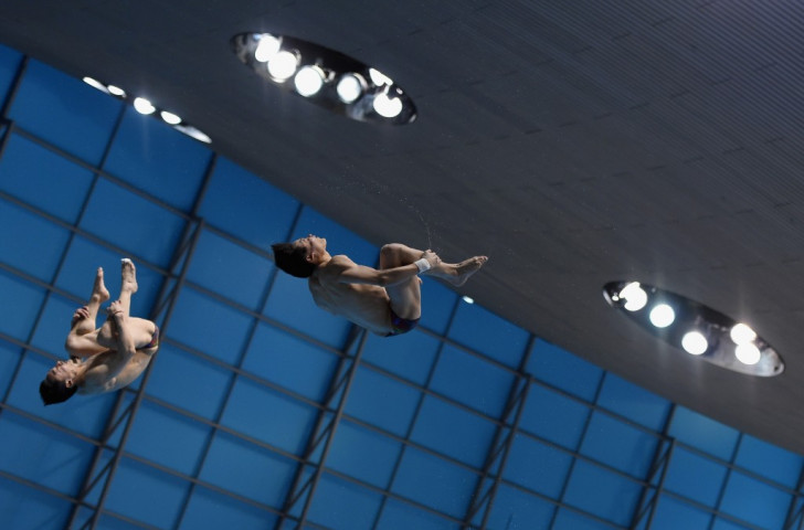 Qin Kai and Yuan Cao took the men's 3m synchronised springboard crown