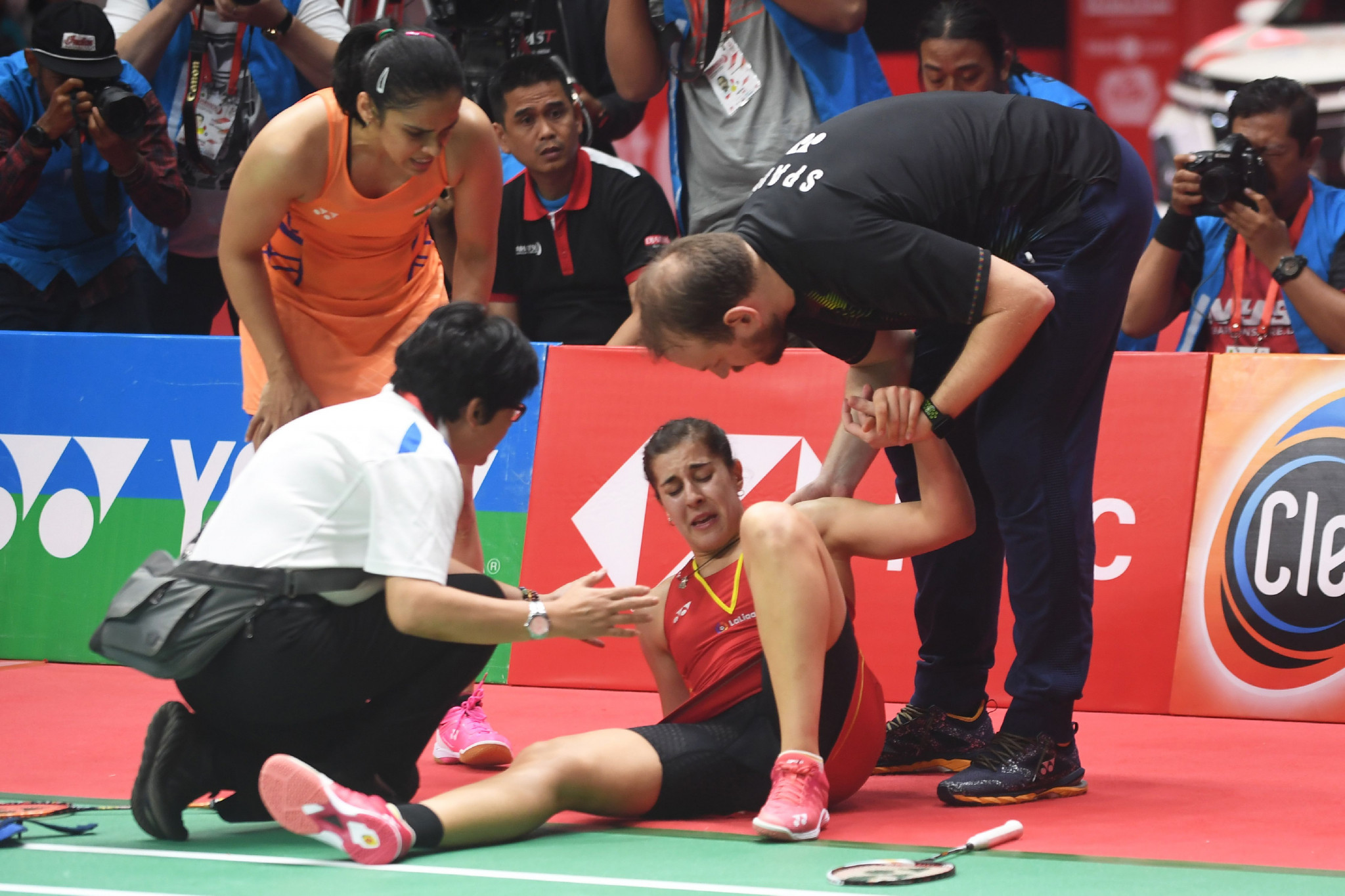 Spaniard Carolina Marin was forced to retire from the women's singles final against Saina Nehwal ©Getty Images