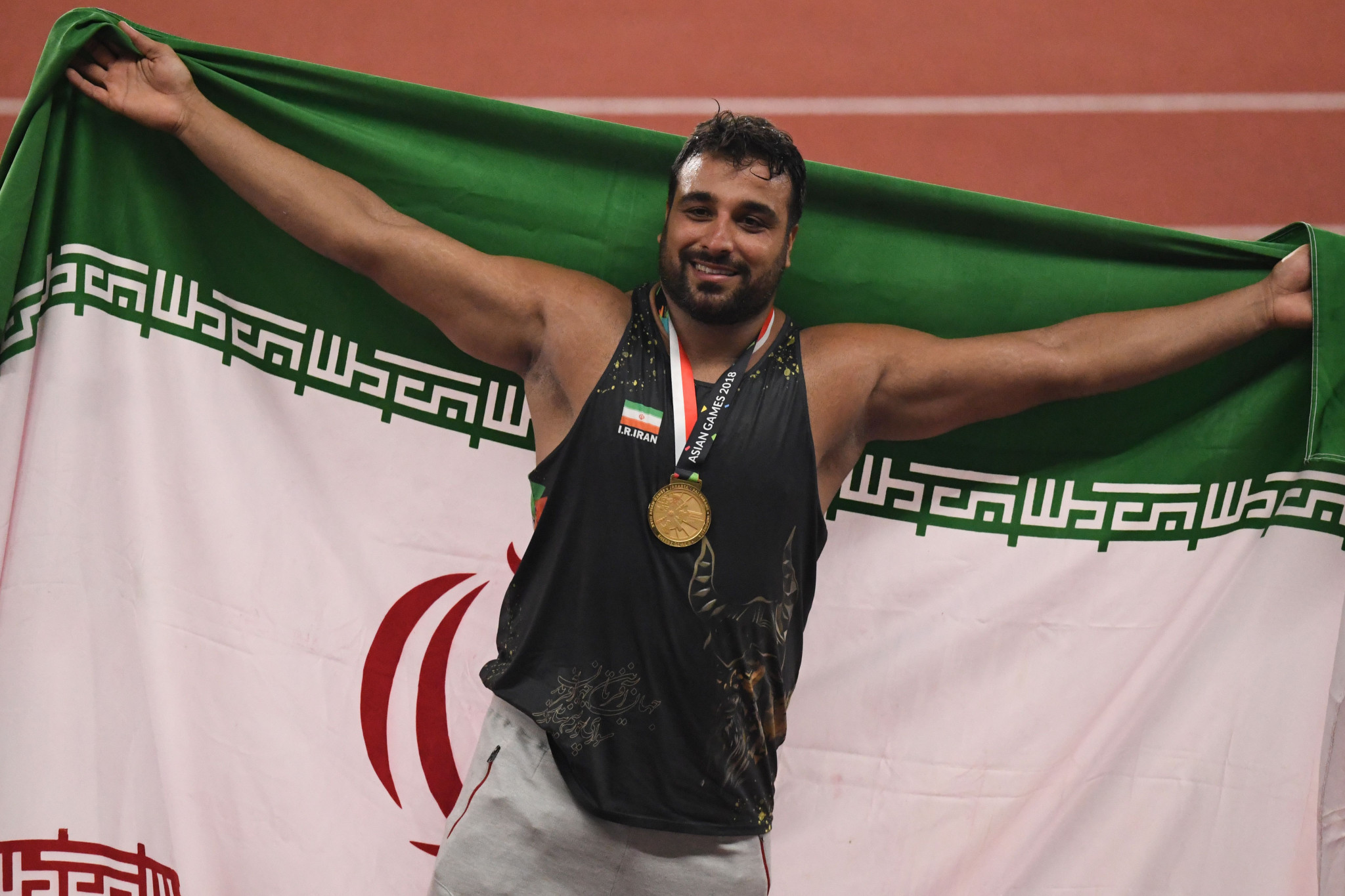 Discus thrower Ehsan Haddadi has also donated memorabilia ©Getty Images