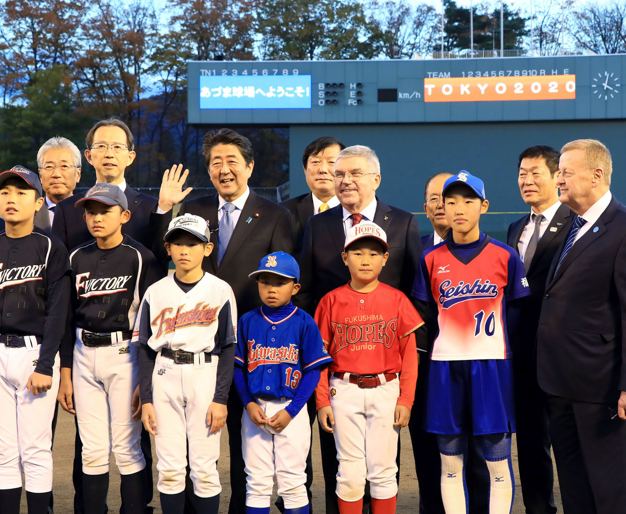 IOC President Thomas Bach and Japanese Prime Minster Shinzo Abe visited Fukushima last November and met some young baseball players from the area devastated by the earthquake and tsunami ©Getty Images