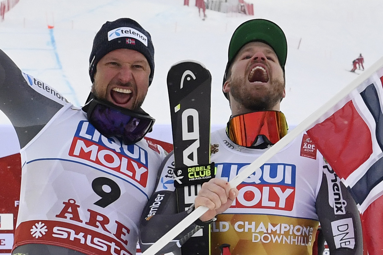Norway's Aksel Lund Svindal, left, celebrated the end of his career with the silver medal ©Getty Images