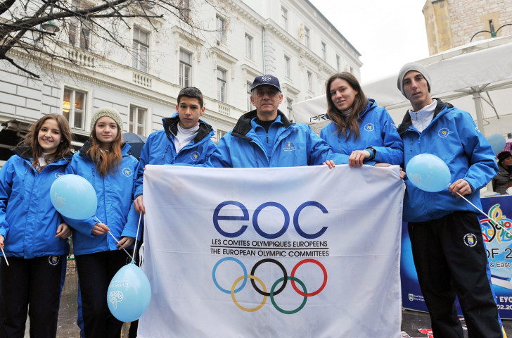 Members of the Bosnian team pose with the European Olympic Committees flag in Sarajevo ©Getty Images