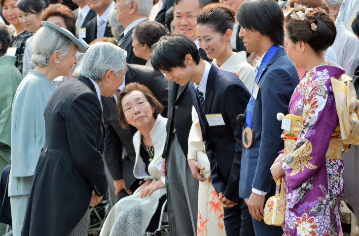 Japan's 19-year-old Yuzuru Hanyu, winner of the 2014 Winter Olympic men's figure skating title on Valentine's Day, feels the love as he is introduced to the Emperor and Empress of Japan during the annual spring garden party at the Akasaka Palace imperial garden in Tokyo ©Getty Images