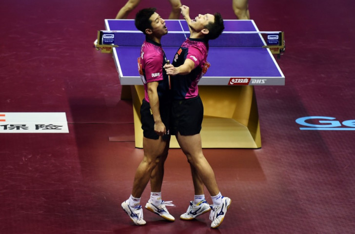 Xu Xin and Zhang Jike celebrate after winning the men's doubles title
