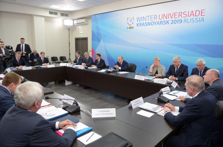 Russian President Vladimir Putin, pictured centre last February chairing a meeting on preparations for Krasnoyarsk 2019, has kept a keen eye on all developments since ©Getty Images