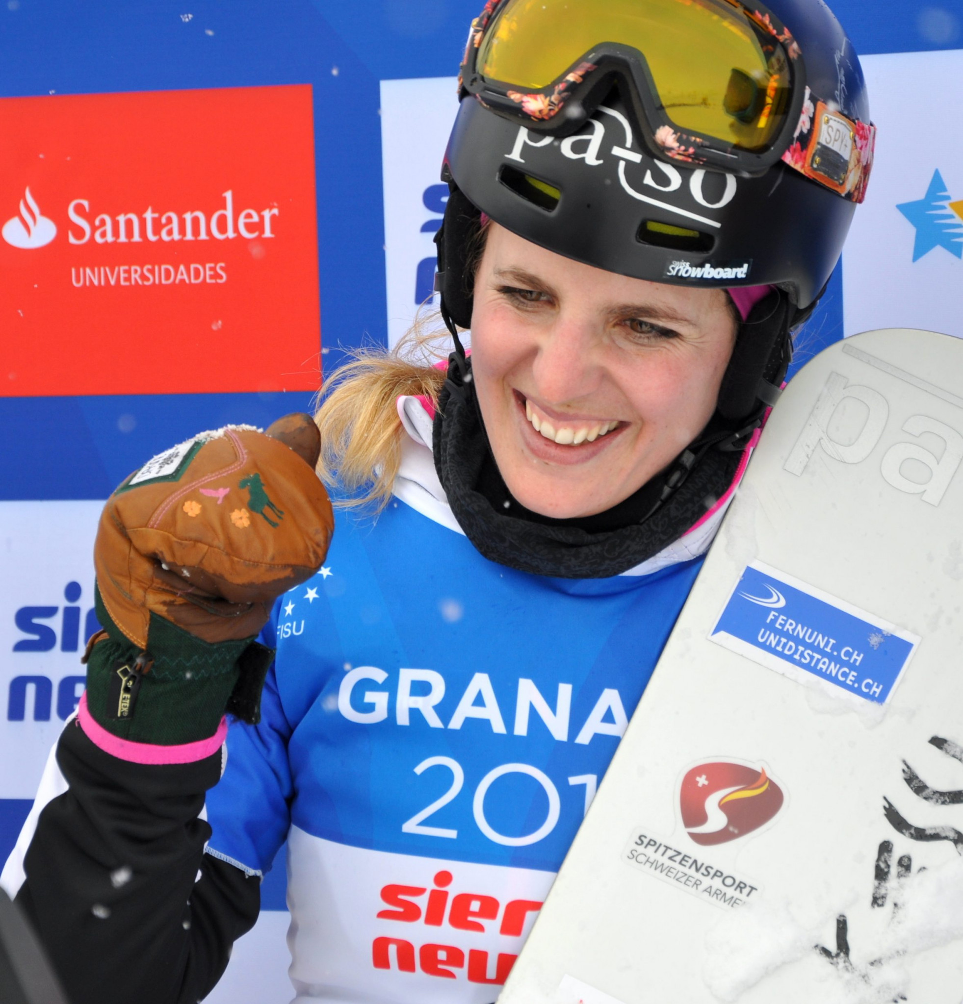 Switzerland's Patrizia Kummer celebrates her Winter Universiade gold medal in the parallel giant slalom at Granada 2015 - a year after she had won the Olympic gold medal in Sochi ©Patrizia Kummer