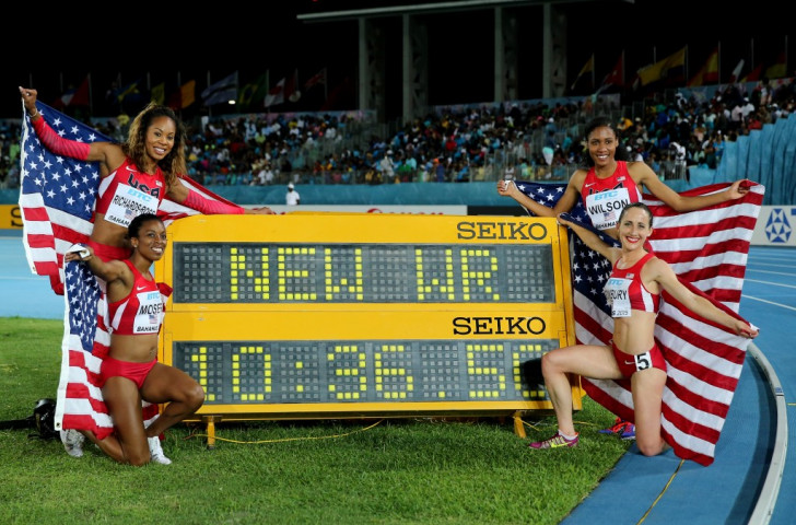 The US women celebrate their victory in the new event of the distance medley in Nassau