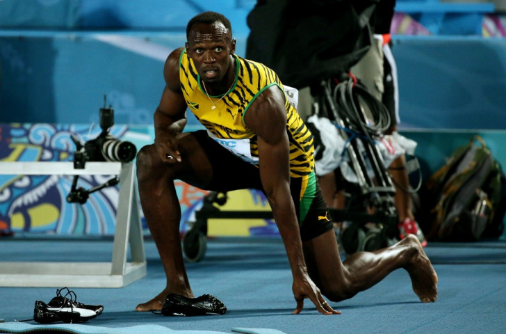Usain Bolt contemplates an unsatisfactory night at the IAAF World Relays in Nassau