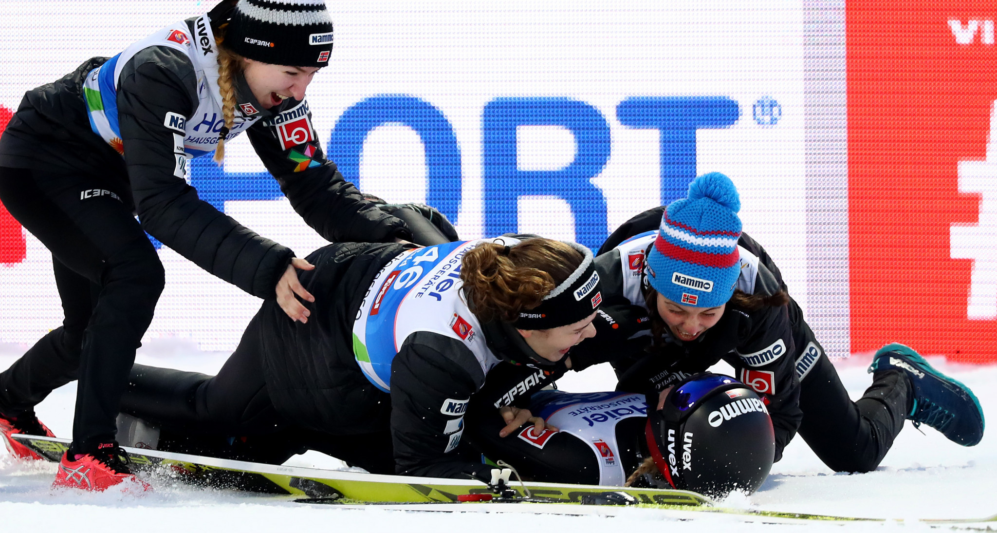 Back on the snow Norway's Maren Lundby was swamped by her teammates after winning the women's ski jumping final ©Getty Images