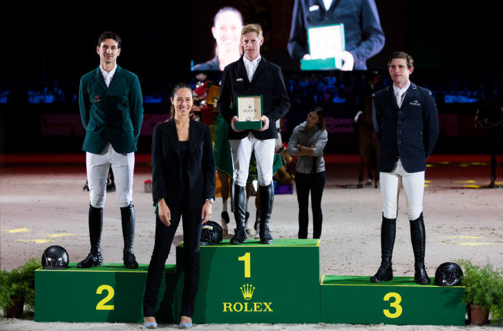 Germany's Marcus Ehning tops the podium at the Rolex Grand Prix in Geneva last December to stay in the running for the overall Grand Slam title ©Rolex Grand Prix