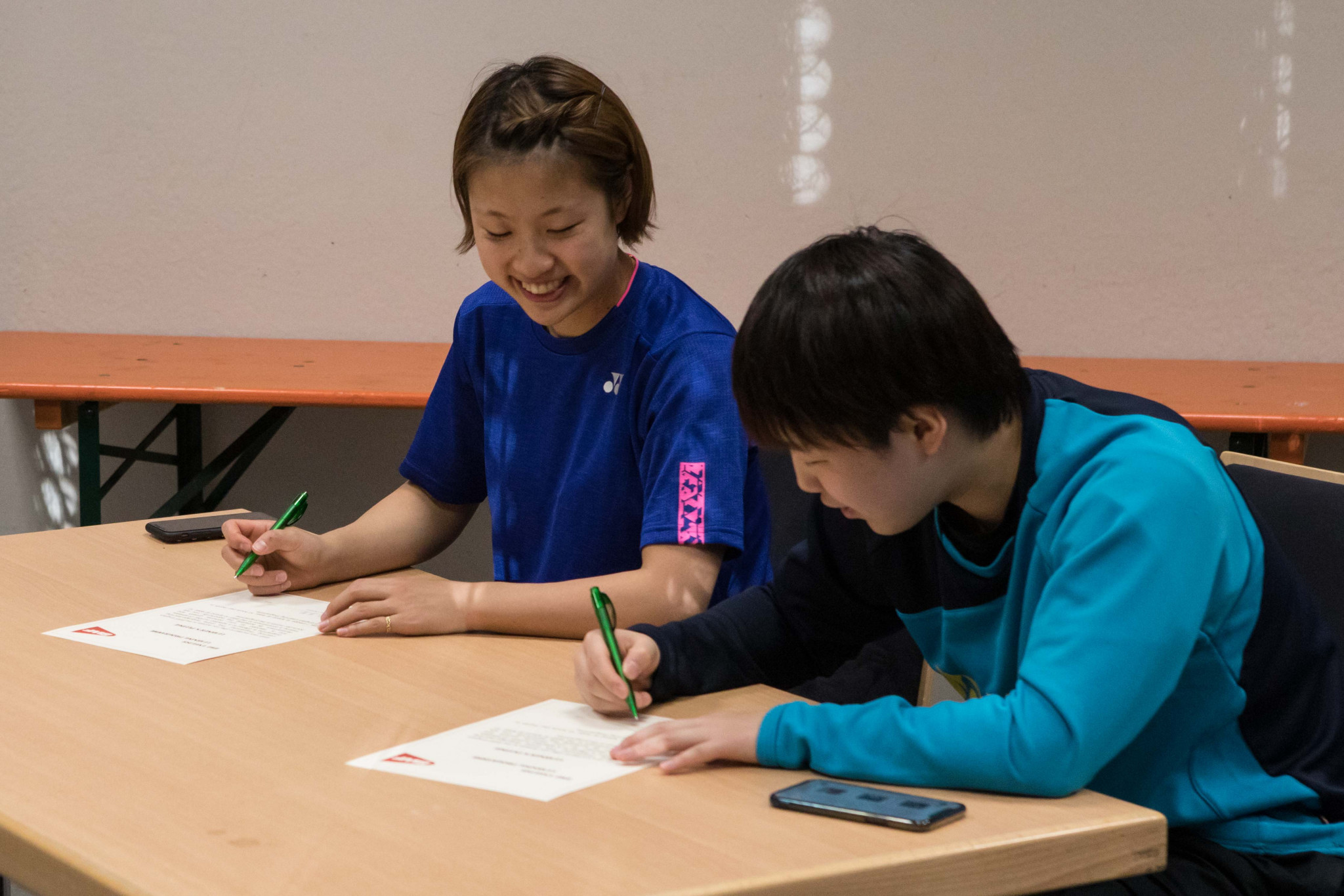 Japan's world ranked number two Nozumi Okuhara, left, and compatriot Akane Yamaguchi get involved in the pilot scheme of the BWF English learning programme ©BWF