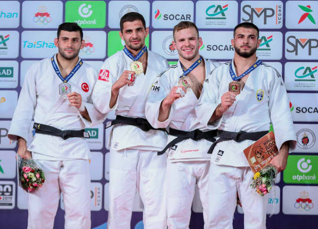 Bulgaria's Ivaylo Ivanov, second left, won gold in the men's under-81kg category on the second day of action at the IJF Marrakech Grand Prix ©IJF