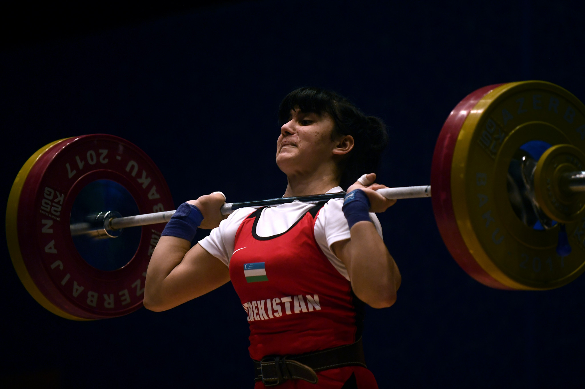 Kumushkhon Fayzullaeva won the hat-trick of overall, snatch and clean and jerk titles in the women's 64 kilograms division ©Getty Images