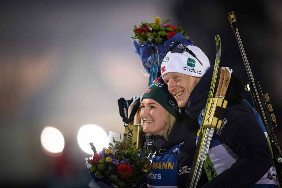 Norway's Johannes Thingnes Bø and Marte Olsbu Røiseland celebrate victory for Norway in the first single mixed relay to be staged at the IBU World Championships ©IBU