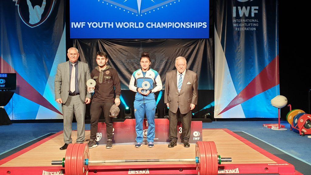Saikhan Taisuyev, centre left, and Kumushhkon Fayzullaeva, centre right, were named as best lifters at the IWF Youth World Championships in Las Vegas ©IWF