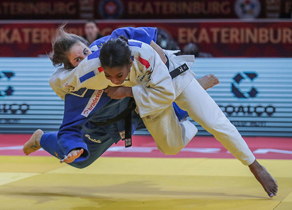France's Eve Gahie, in white, defeated Brazil's Maria Portela in the final of the under-70kg event to win the second IJF Grand Slam title of her career ©IJF
