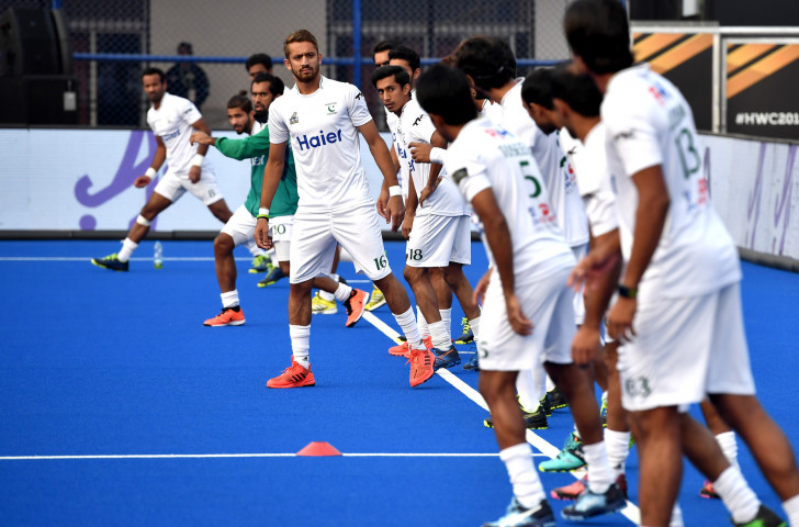 Pakistan, pictured warming up before a match at last year's FIH World Cup in India, face a possible ban for their late withdrawal from the FIH Pro League on financial grounds  earlier this year ©Getty Images