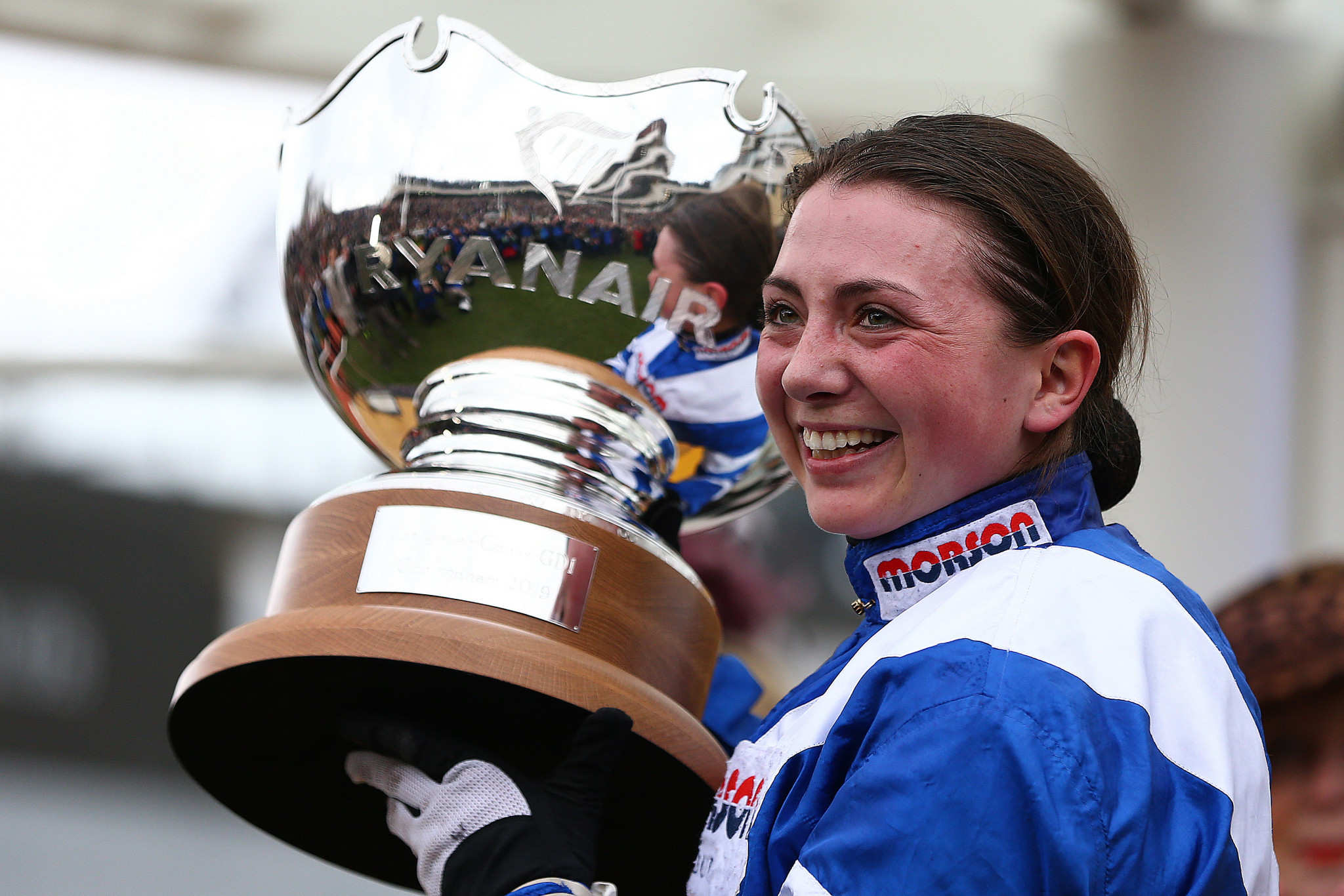 Jockey Bryony Frost poses with the trophy after she rides Frodon to victory during the Ryanair Chase ©Getty Images
