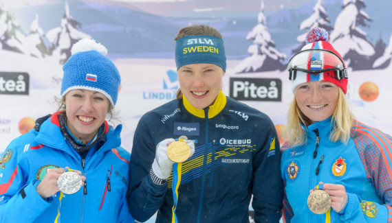 Home favourite Tove Alexandersson, centre, won the women's long-distance event on the opening day of the IOF World Ski Orienteering Championships in Piteå in Sweden ©IOF