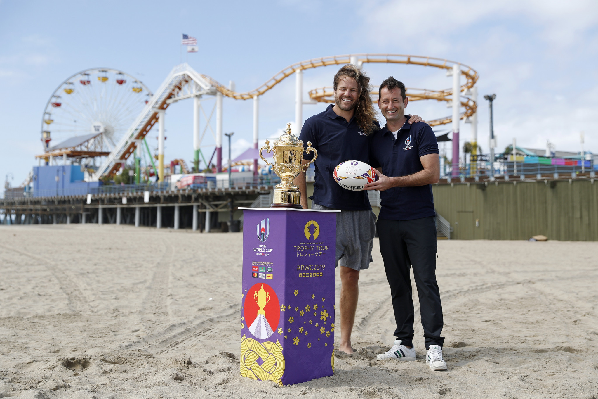 Former United States rugby captain Todd Clever, left, and ex-player Dallen Stanford, right, both joined the trophy on its tour around Los Angeles ©Rugby World Cup