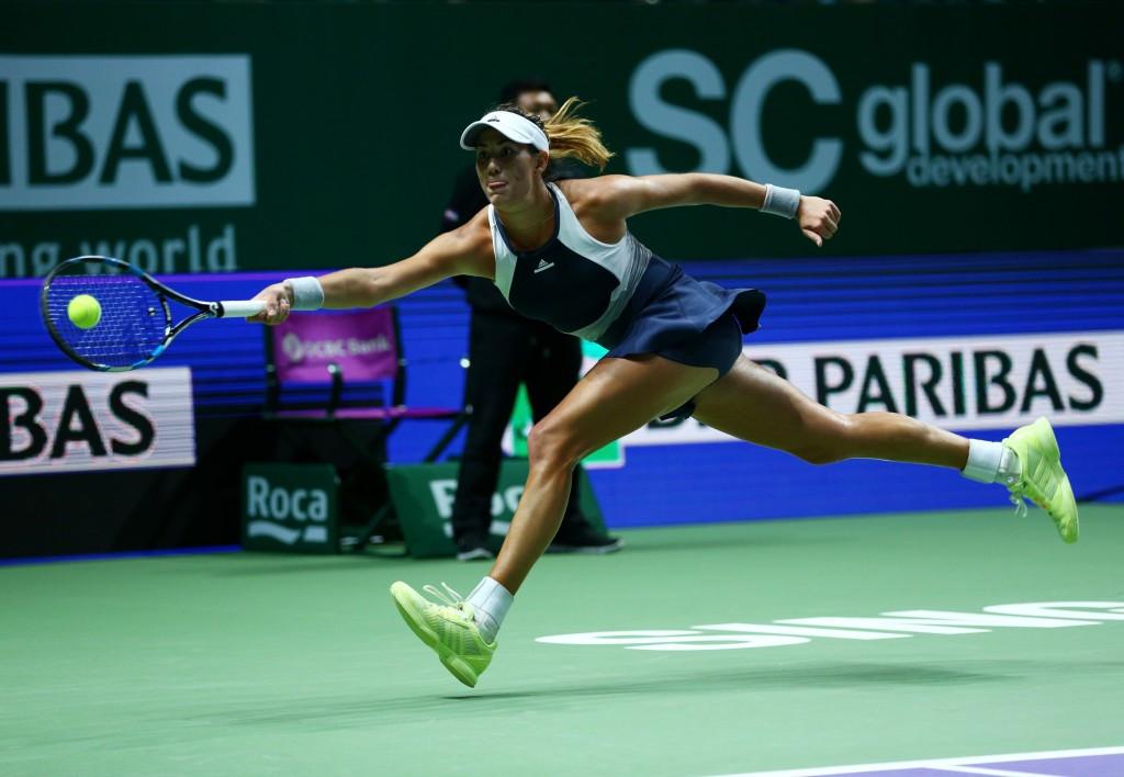 World number three Muguruza turns the tables to make winning start at WTA Finals