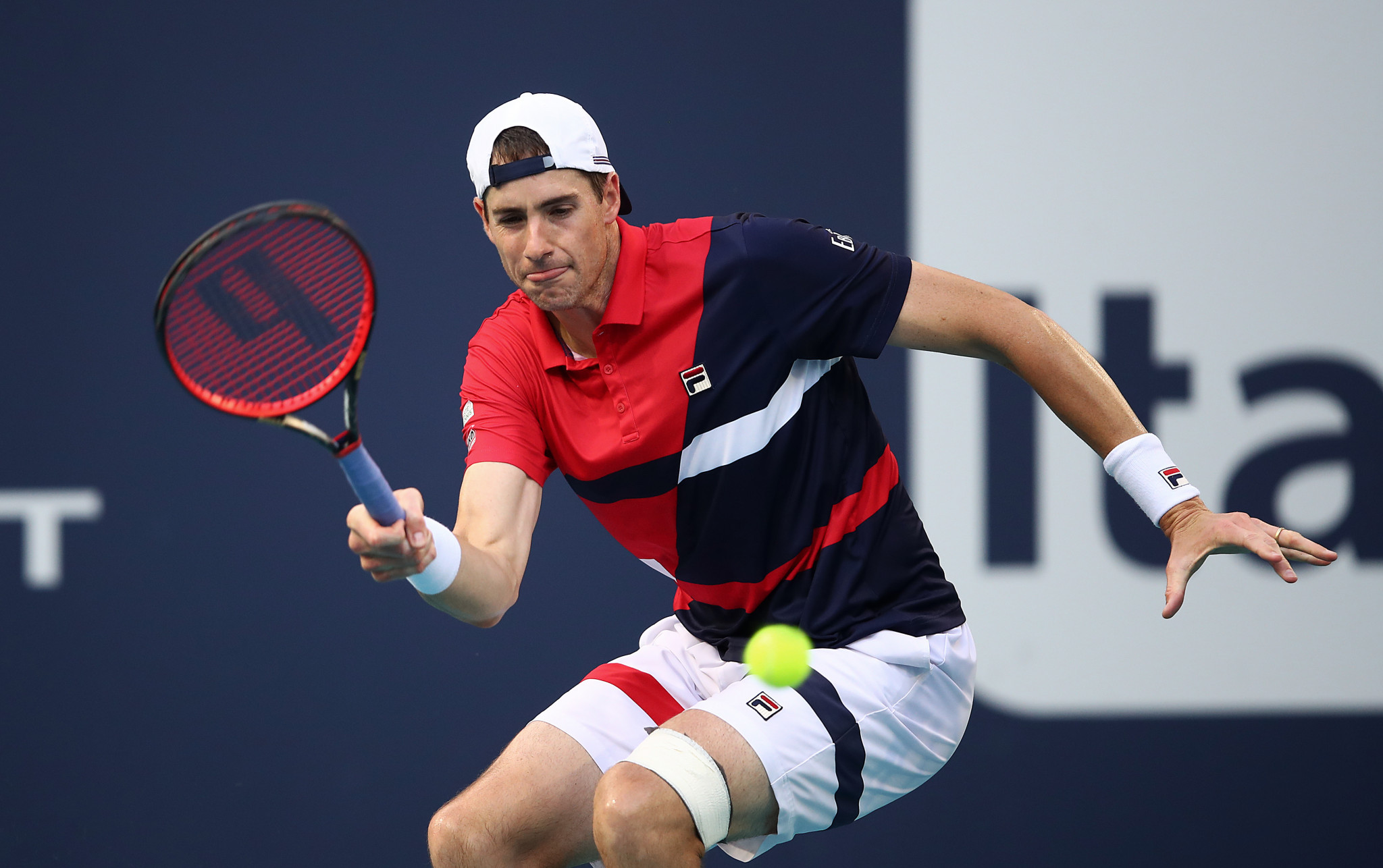 Defending champion Isner reaches Miami Open semi-finals