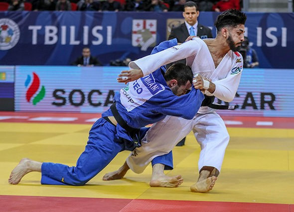 Georgia's Lukhumi Chkhvimiani triumphed at his home IJF Grand Prix for the third consecutive year, defeating France's Walide Khyar in the men's under-60kg final ©IJF