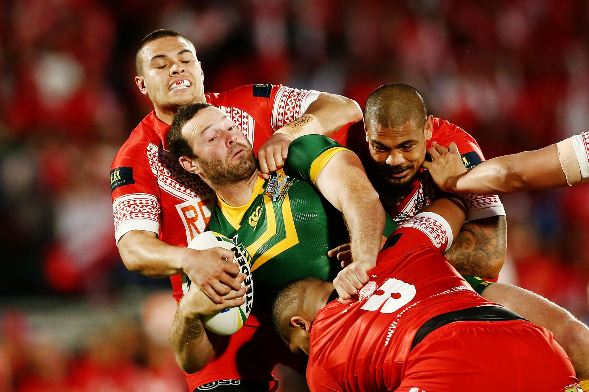 Boyd Cordner of Australia is tackled by Tuimoala Lolohea and Sika Manu of Tonga during the Test between Tonga and Australia in October last year ©Getty Images