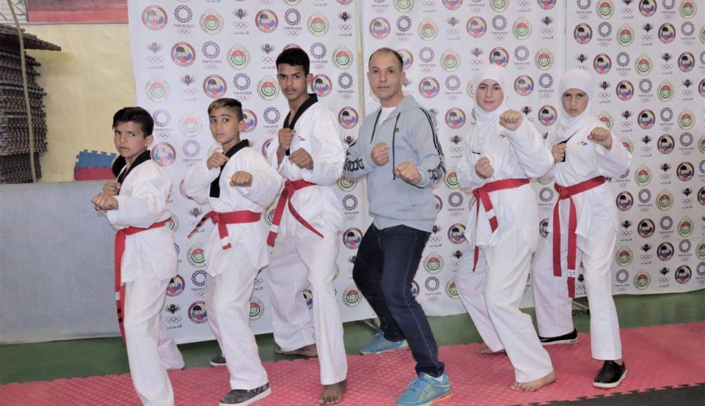 THF continues to deliver as five refugees pass black belt test at Azraq Taekwondo Academy