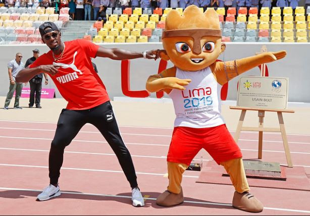 Usain Bolt and Milco, the Lima 2019 mascot, pictured in the newly renovated athletics stadium in Peru's capital ©LIma 2019