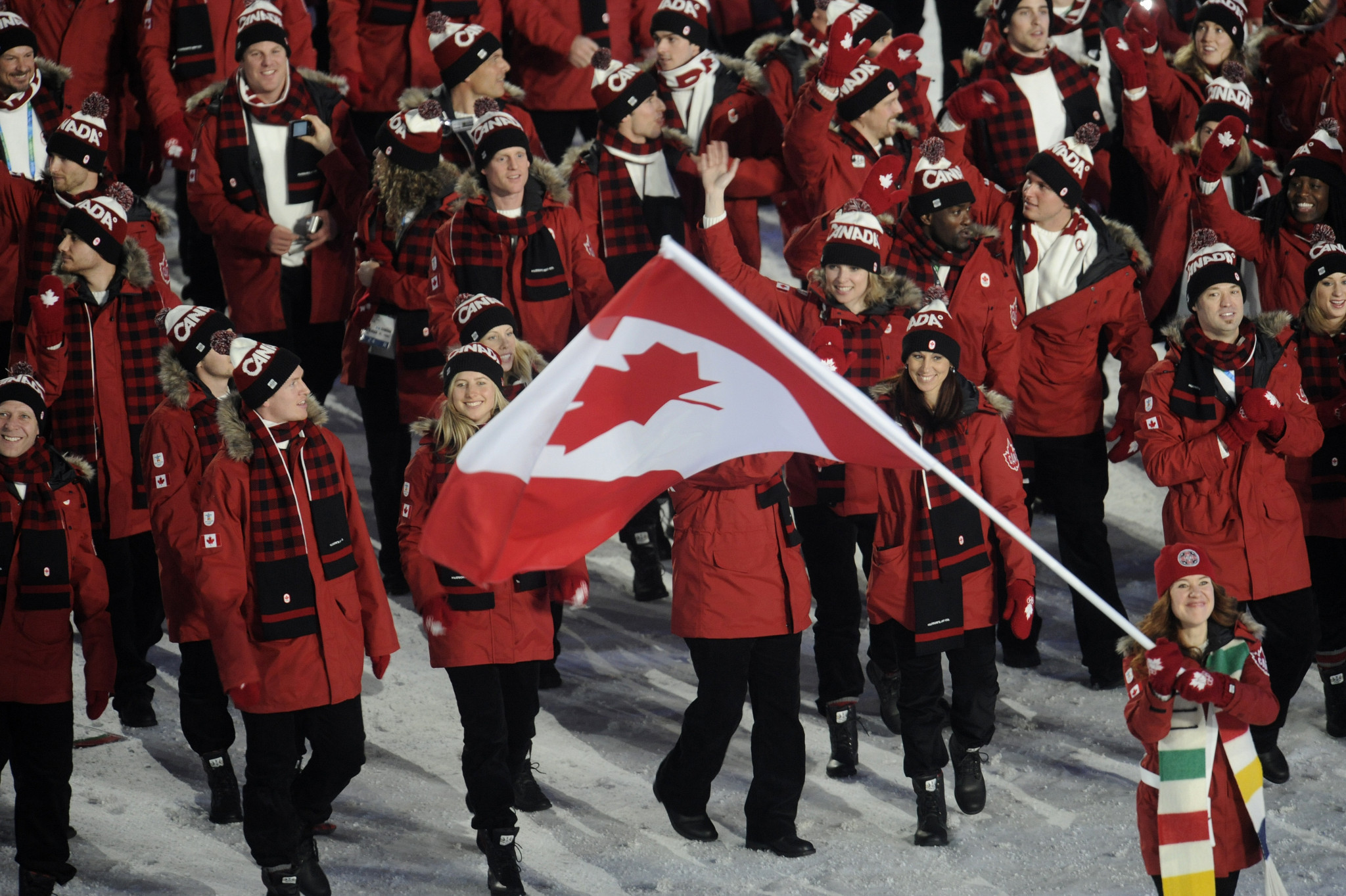 Canada's athletes at the Opening Ceremony of the 2010 Winter Olympic Games in Vancouver, clad in their regulation red parkas - with faux fur trim ©Getty Images