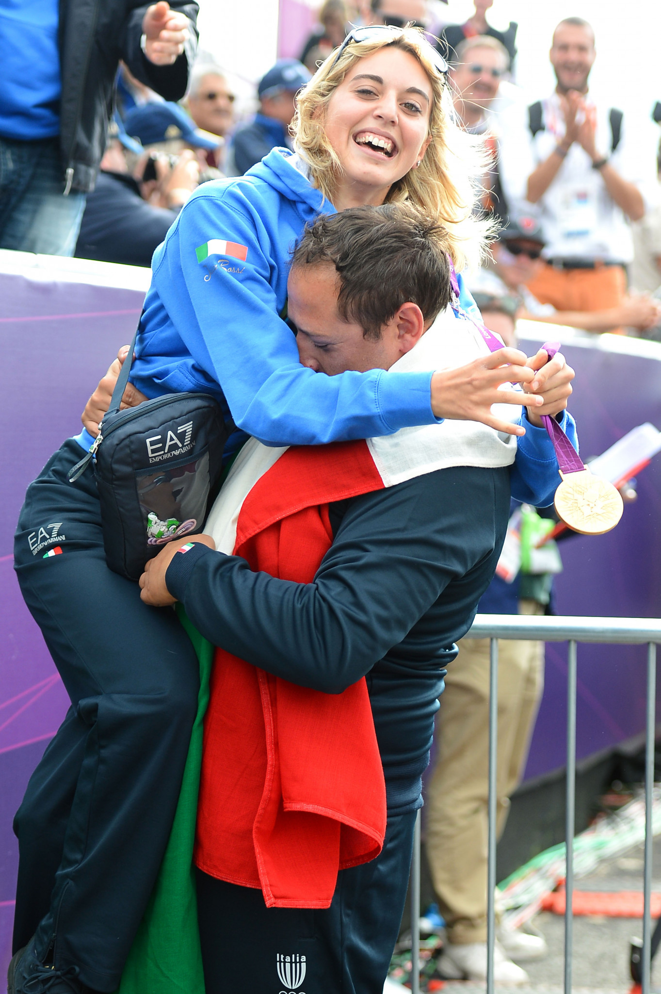 Italy's Jessica Rossi, pictured celebrating victory at London 2012, is well placed ahead of tomorrow's women's trap final in the ISSF Shotgun World Cup in the United Arab Emirates ©Getty Images