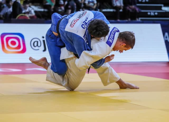 Mikail Ozerler, right, earns gold for the host nation on the last night of the IJF Grand Prix in Antalya ©IJF