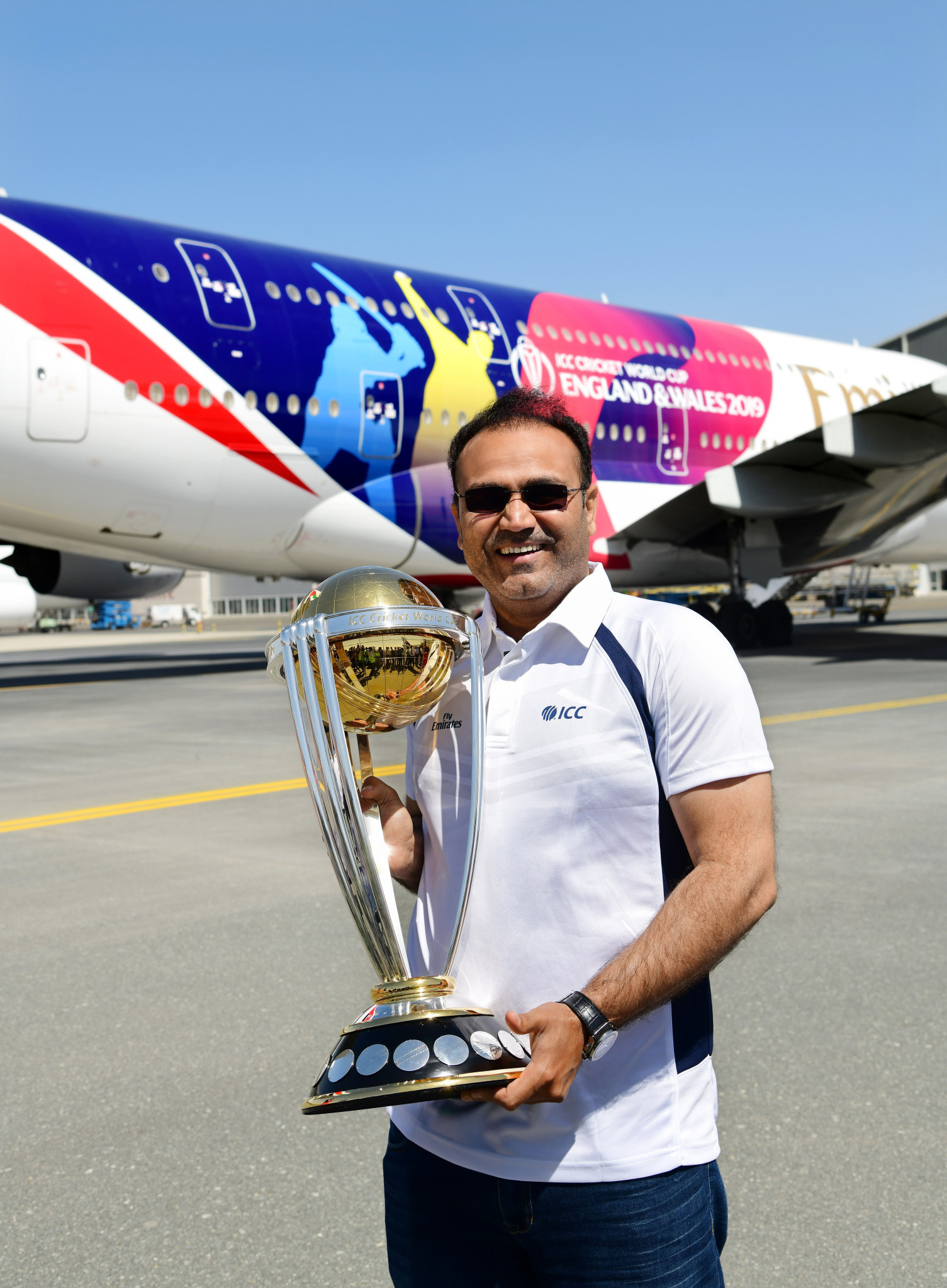 Former India cricketer Virender Sehwag showed off the Men's Cricket World Cup trophy ©ICC