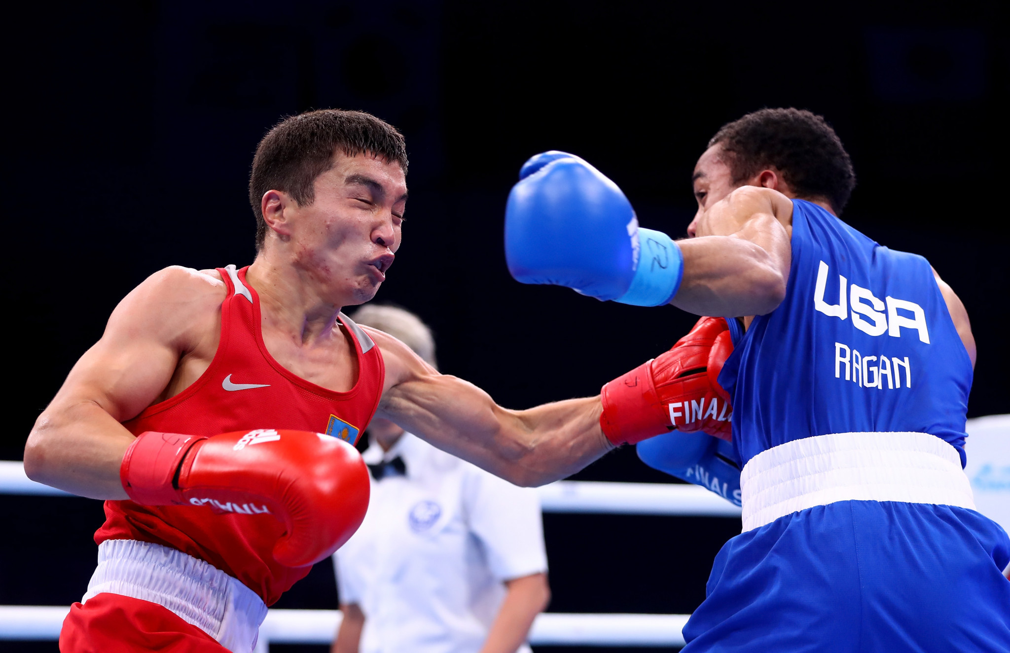 Reigning world champion Kairat Yeraliyev of Kazakhstan, left, was among the other casualties on day four ©Getty Images