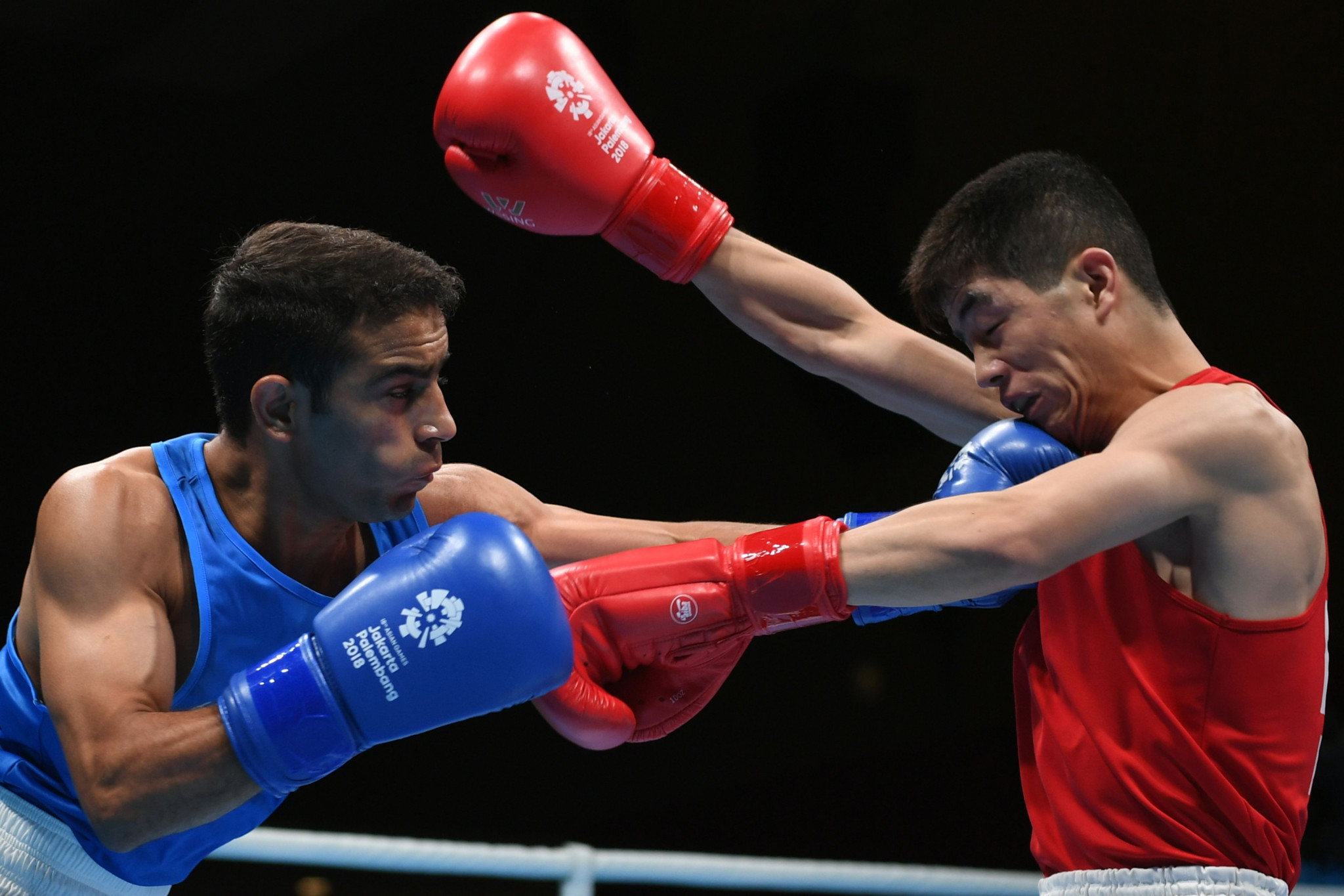 Asian Games champion Amit Panghal of India earned another victory over Uzbekistan's Olympic gold medallist Hasanboy Dusmatov ©Getty Images