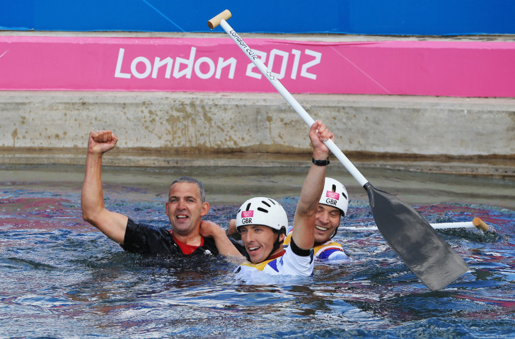 Etienne Stott, pictured centre with team-mate Tim Baillie after winning the Olympic gold medal in the men's double C2 canoe event at London 2012, was among 963 arrested in Britain's capital during protests about climate change ©Getty Images